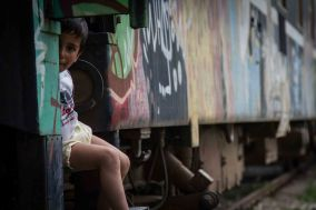 In Idomeni, some live in rusting trains