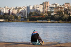 A mother and child sat in Pireaus, the Greek port that now functions as a temporary home
