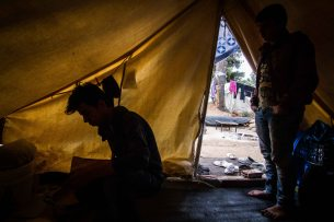 Khalil Mohammed, left, and his younger brother Ivan at their tent in the Ritsona camp. Both took part in a hunger strike protesting at the failings of the Skype relocation system
